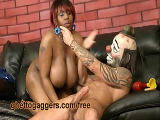 Chubby Black Slut Deepthroats A White Clown
